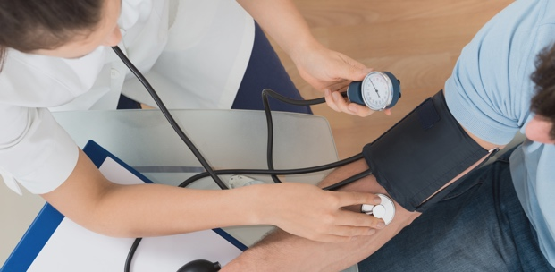 Physician taking a patients blood pressure