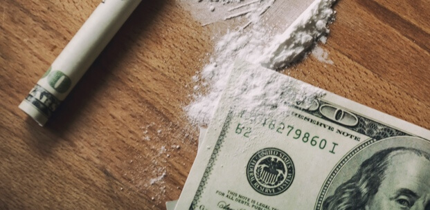 Signs of cocaine abuse include restlessness, dilated pupils and paranoia.