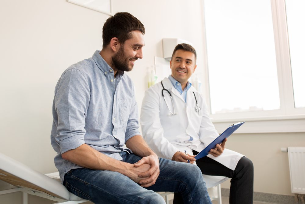 A doctor chats with a patient who is recovering from drug or alcohol addiction.